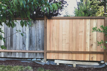 brand-new-fence-slats-in-fence-repair-of-part-of-wooden-fence